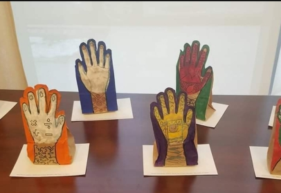 Paper bag hand sculptures capture the student's personalities using symbols and color.