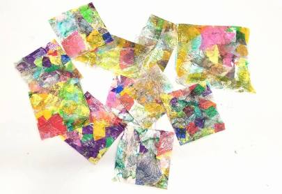 Handmade paper suing tissue paper scraps and Mod Podge.